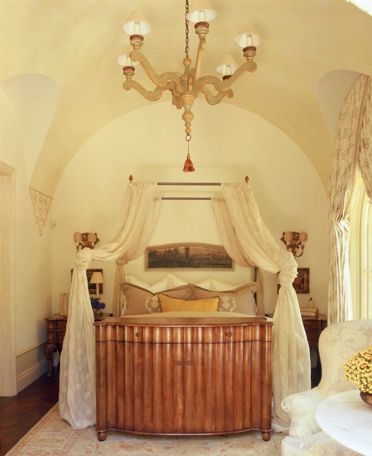 Traditional Bedroom with Anique Wood Chandelier