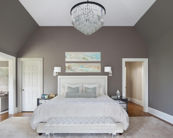 transitional bedroom with charming chandelier lighting