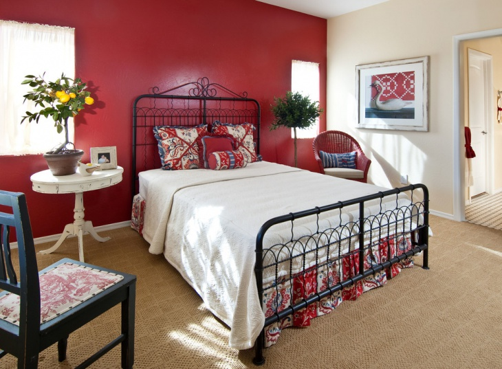 Cottage Style Bedroom with Red Accent Wall