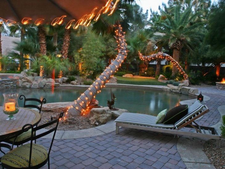 Poolside Palm Trees Wrapped in Decorative Lights