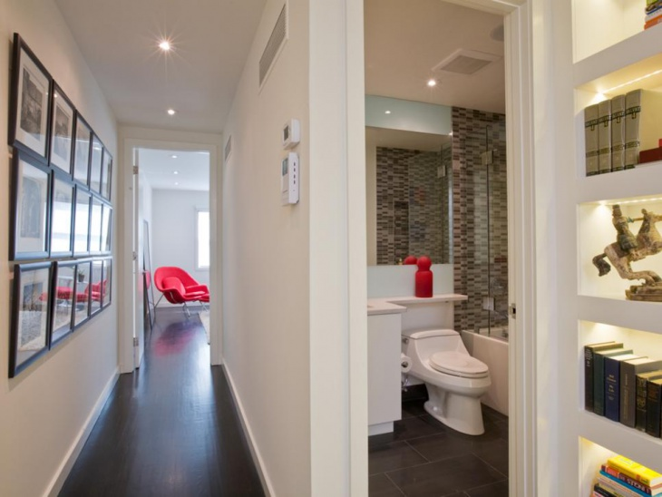 white hallway and bathroom with recessed lights