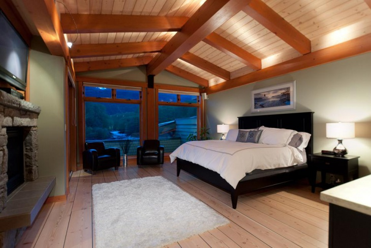 light green bedroom with exposed beam ceiling