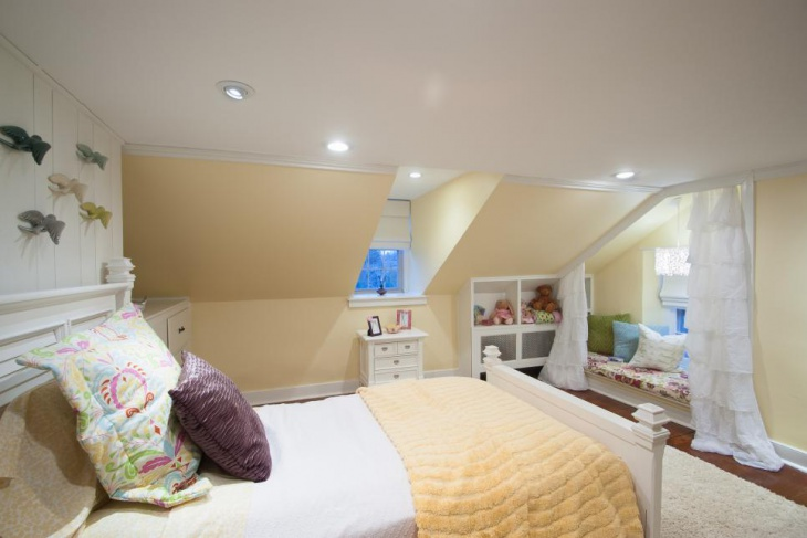 teen bedroom with recessed lighting sloped ceilings