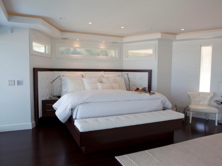 white modern bedroom with plenty of natural lights