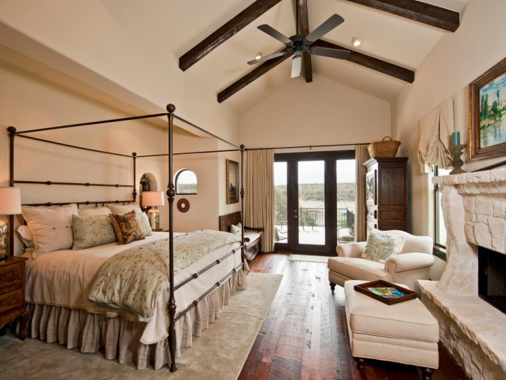 Rustic Master Bedroom With Focus Light on Ceiling