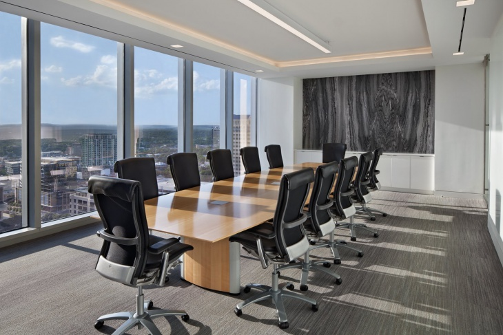 black and white conference room with wooden table