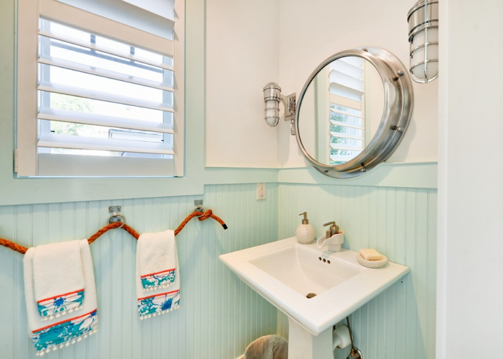 beach style powder room with simple towels
