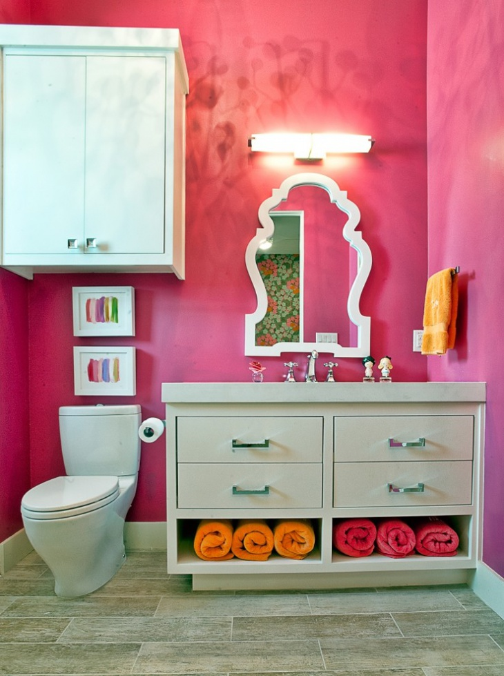pink bathroom with orange towel