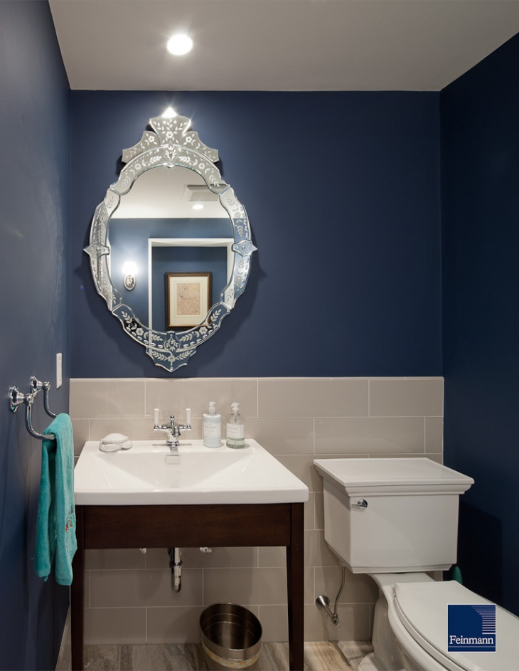 traditional powder room with vibrant blue towel