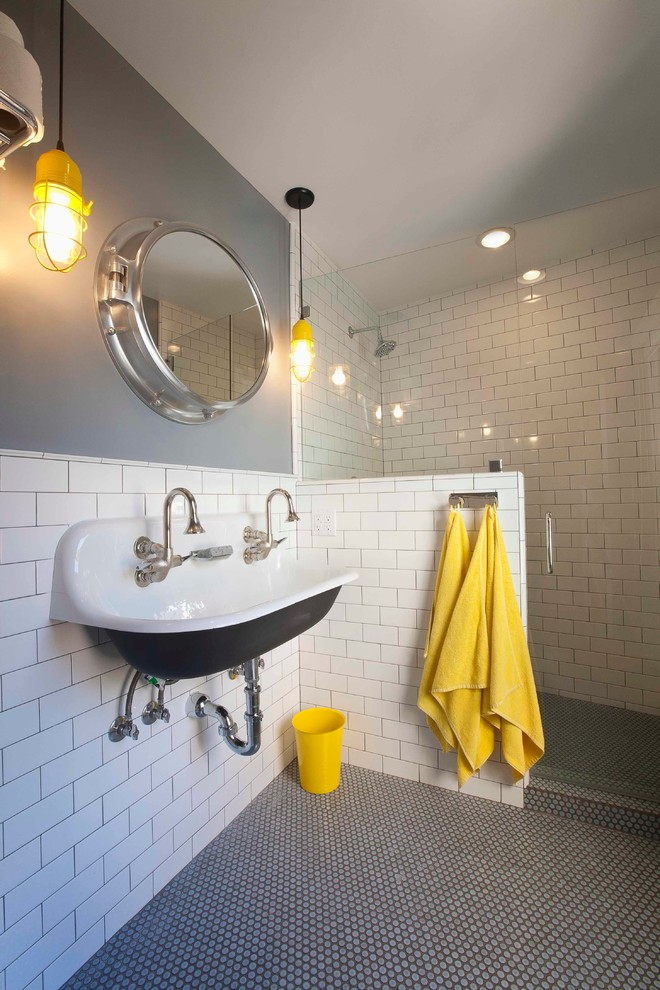 beach style bathroom with yellow towels
