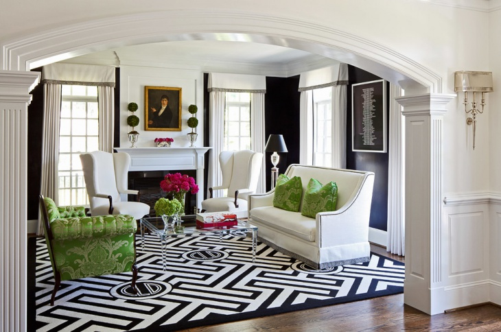 transitional black and white living room with green cushions