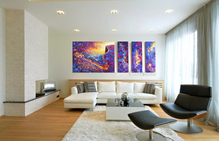 colorful wall paintings in black and white family room