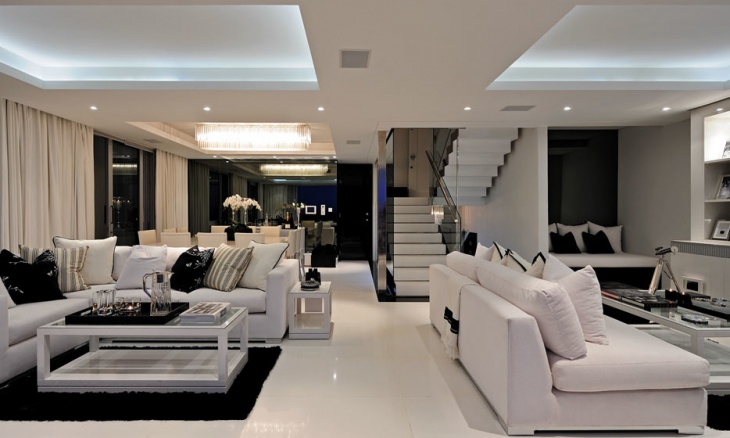 luxurious black and white living area with high ceiling