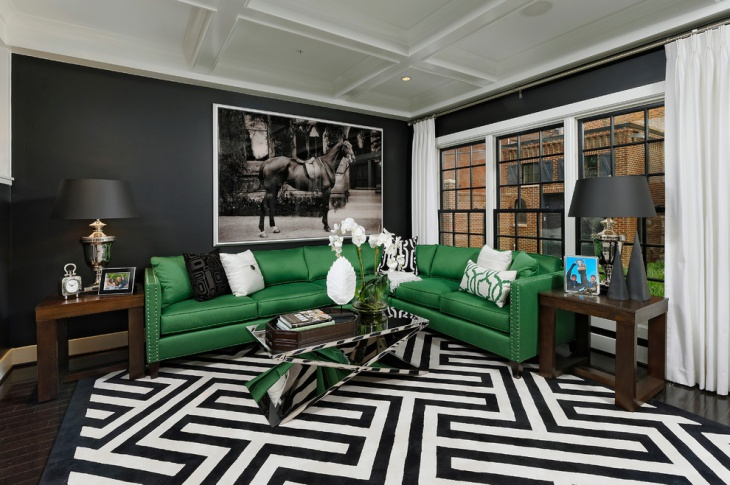 black and white living room with green furniture