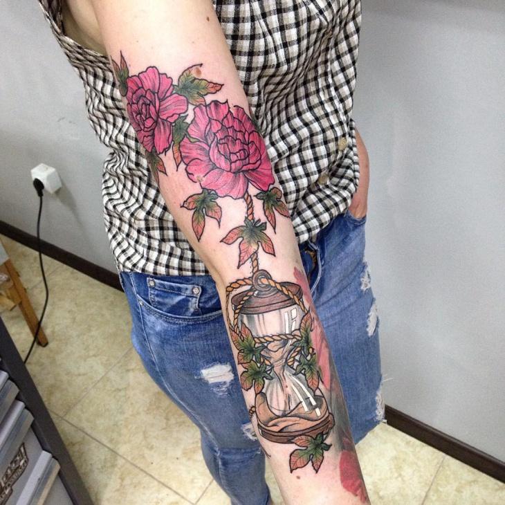 hourglass sunflower hand tattoo