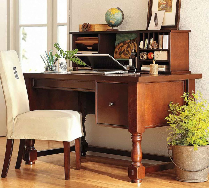 astonishing light brown wooden desk facing white chair next to green plants in the home office decor of bucket
