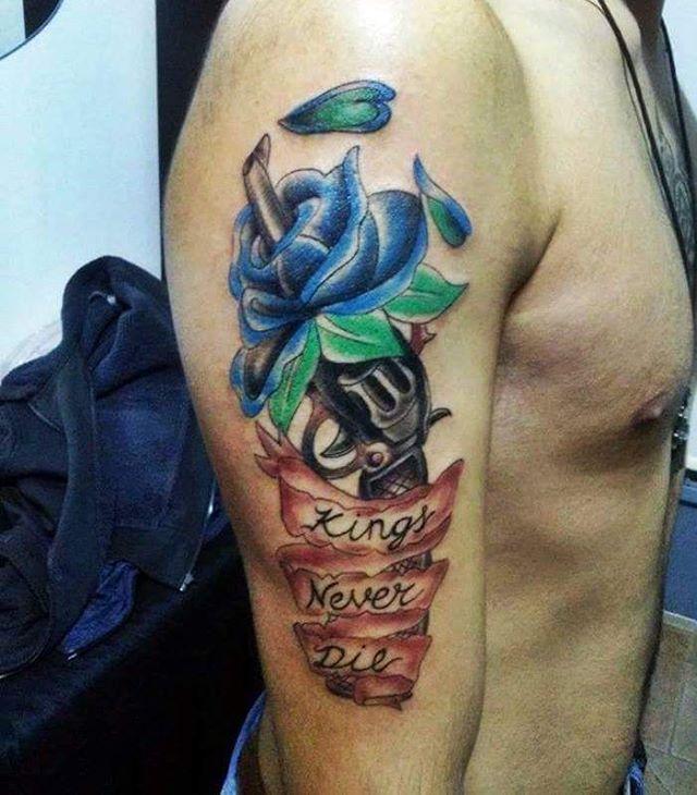 Gun and Flower Tattoo Design
