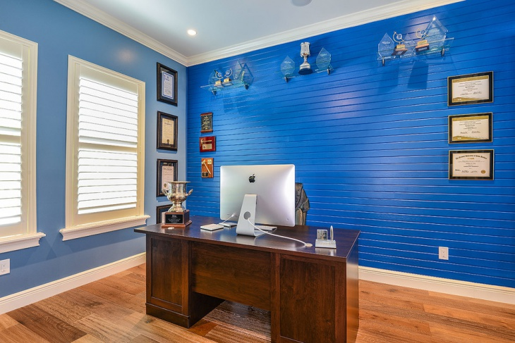 blue home office with wooden floor