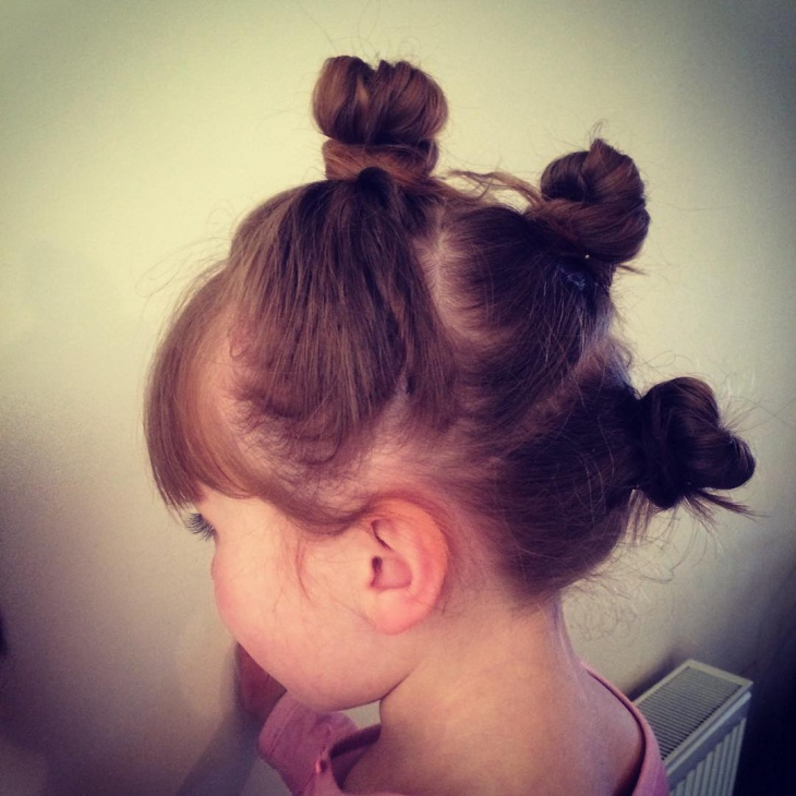 twisted knot hairstyle for child