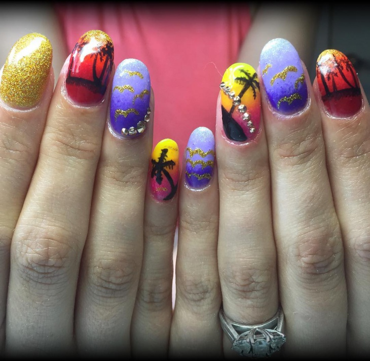 sunset nail design with crystals
