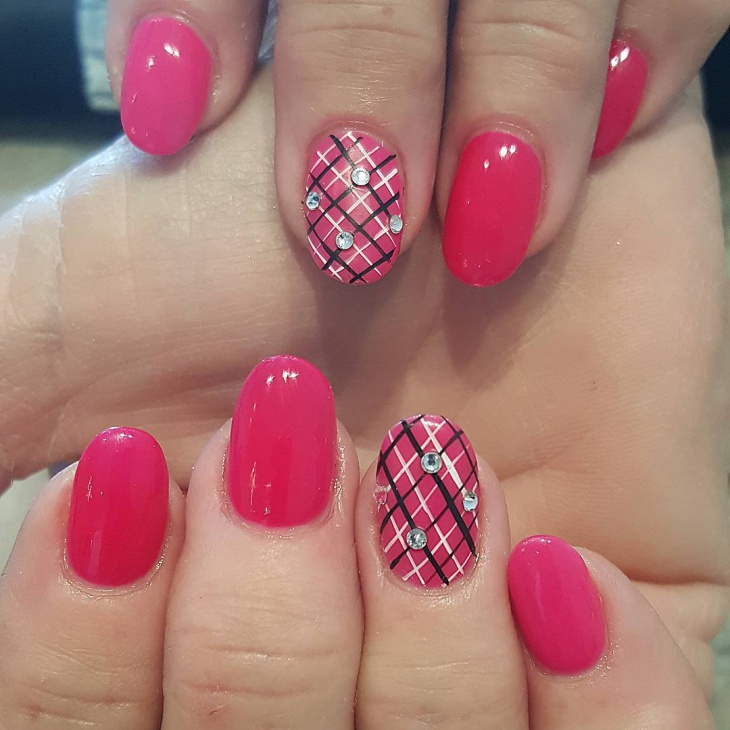 beautiful pink nails with plaid design