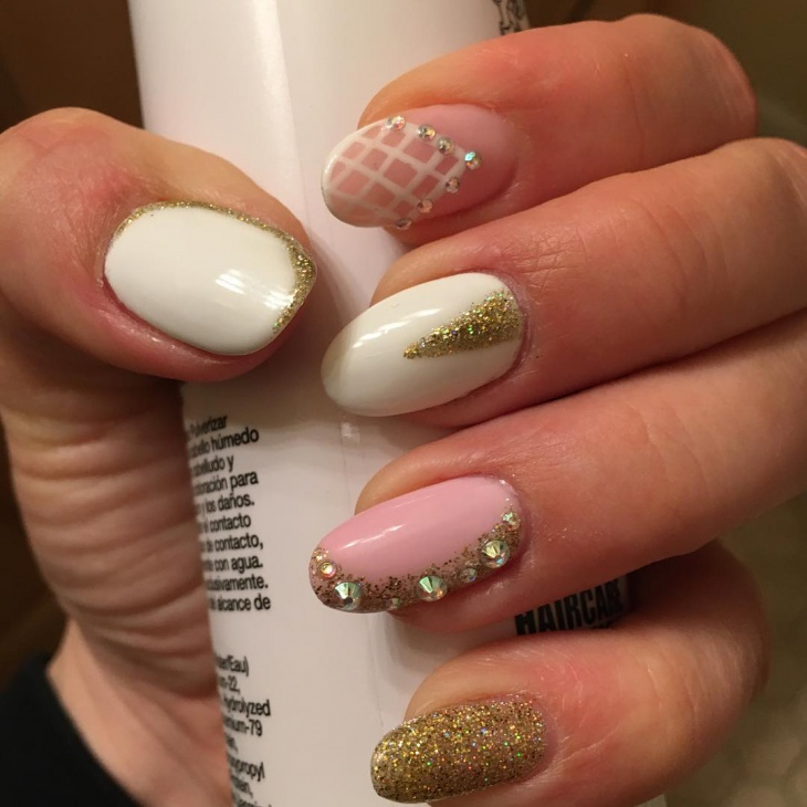 Rhinestone Nails With Gold Glitter