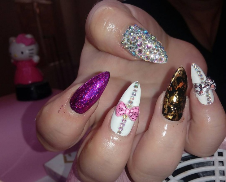 Nail Design With Bow and Rhinestones