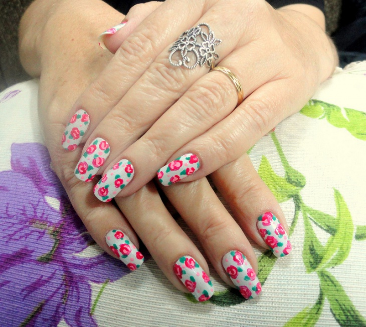 white and pink floral nails