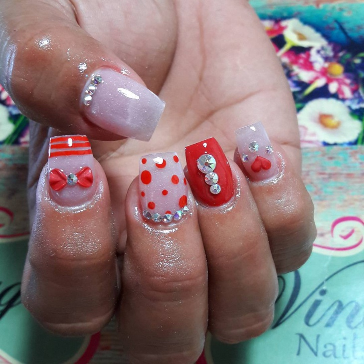 vintage nail art with bow and crystals