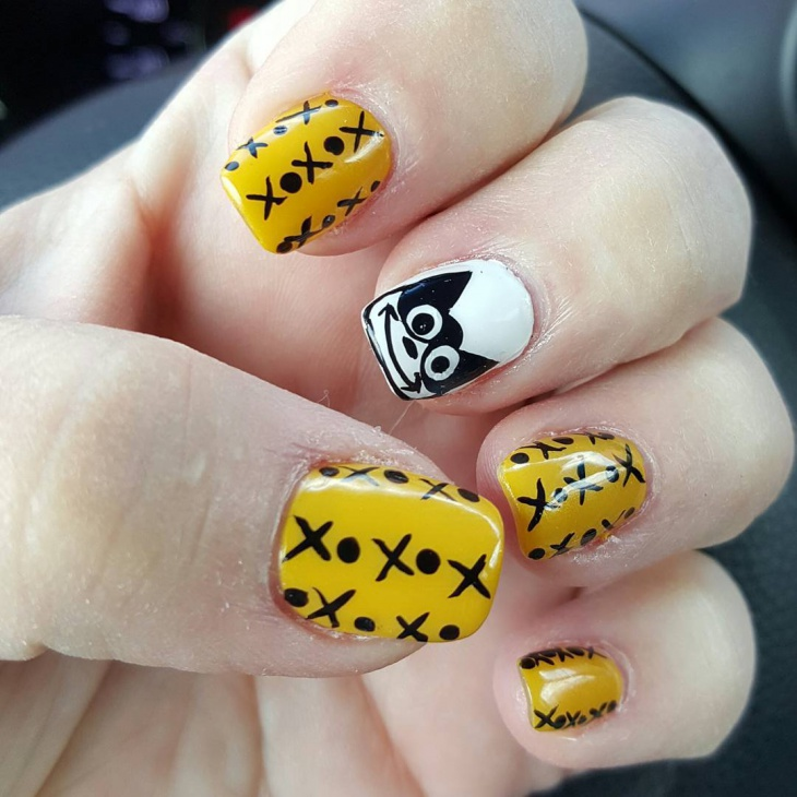 yellow halloween nail art design