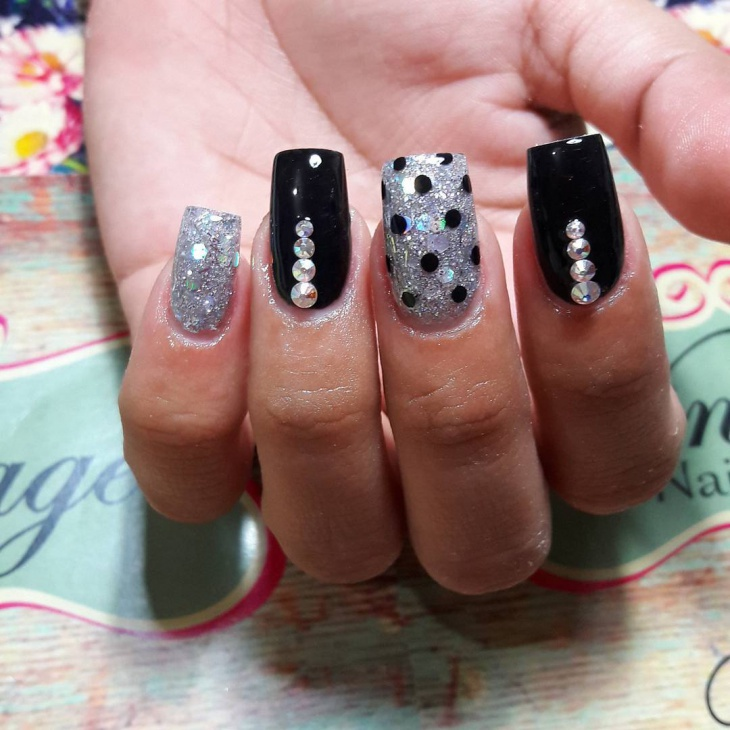 black polka dot nails with silver glitter