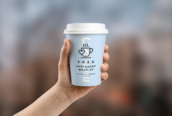 Coffee Cup In Hand MockUp PSD
