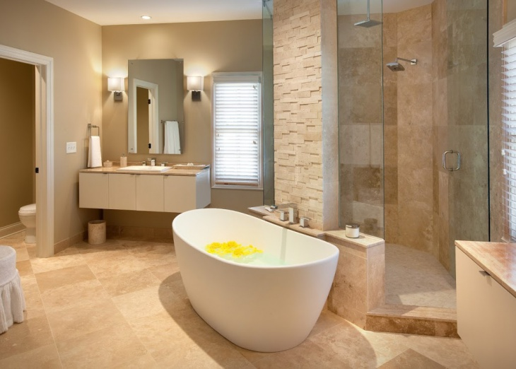 trendy master bathroom with stone wall