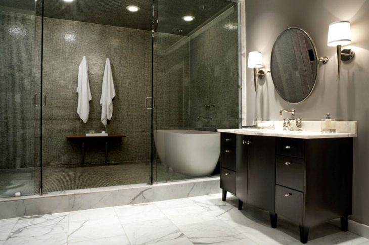 trendy mosaic tile bathroom with glass walls