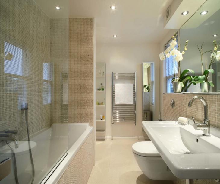 elegant bathroom with glass enclosed tub