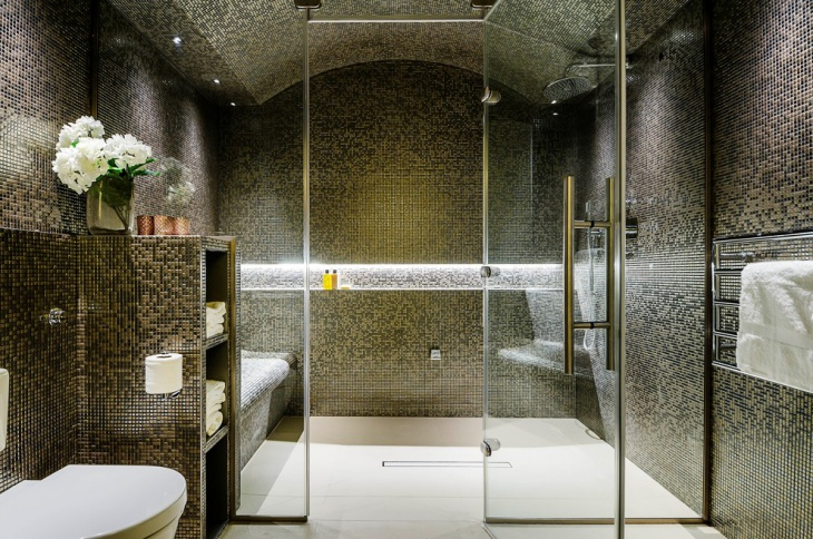 green color tile bathroom with glass shower
