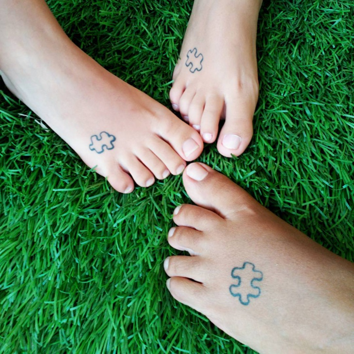 puzzle foot tattoo