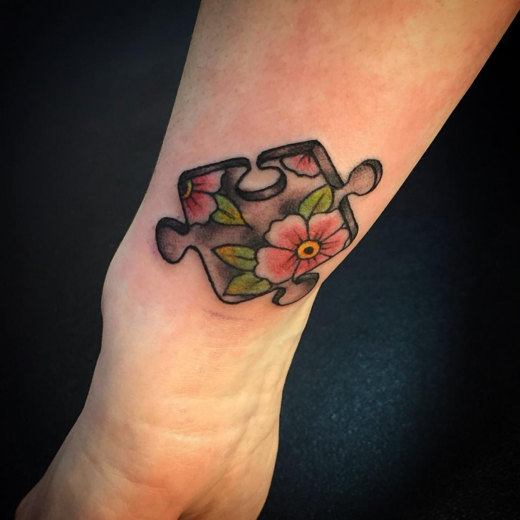puzzle flower hand tattoo