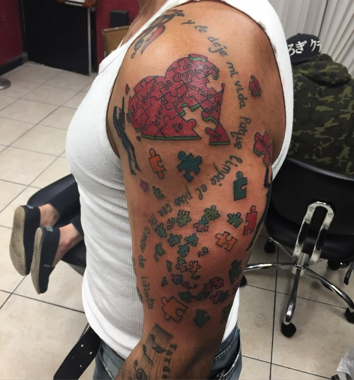 puzzle pieces full sleeve tattoo