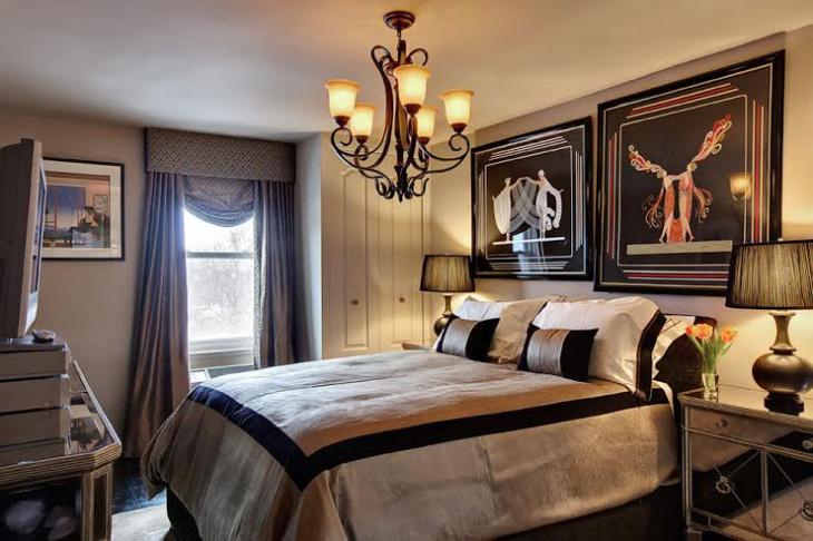 custom bedroom with chandelier