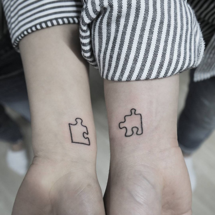 cute and simple puzzle tattoo