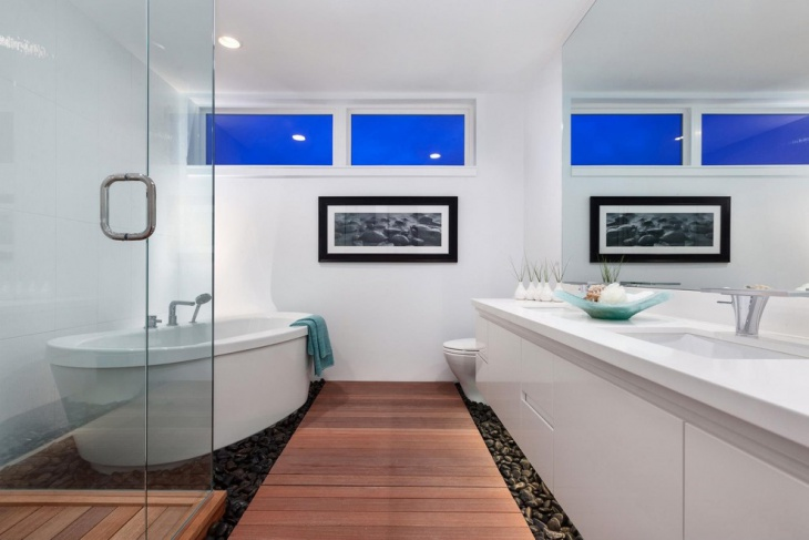 cool white bathroom with river rock floor