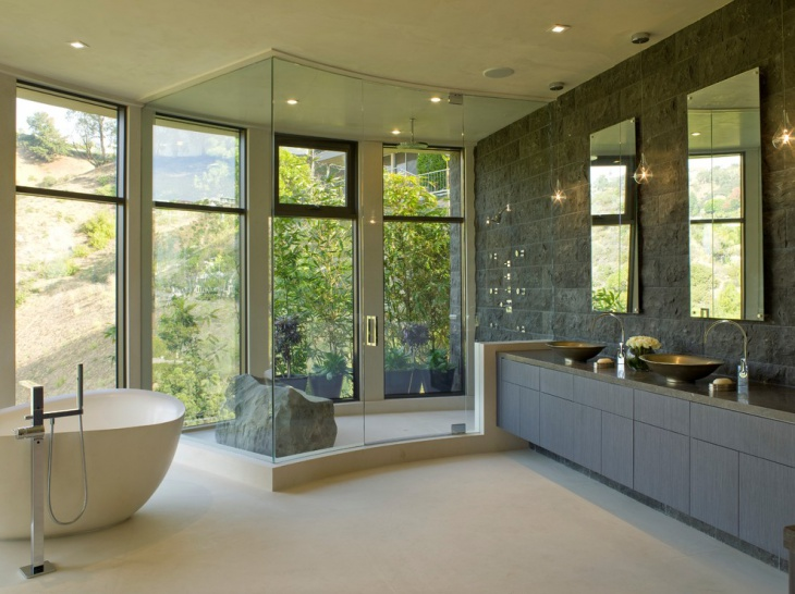 Trendy Bathroom with Stone Wall