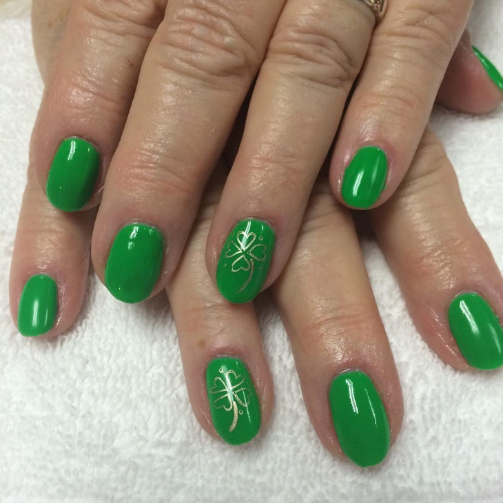 gold shamrock nail art on spring nails