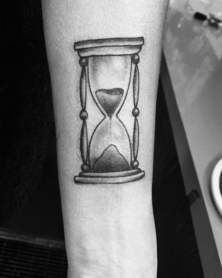 black and white hourglass hand tattoo