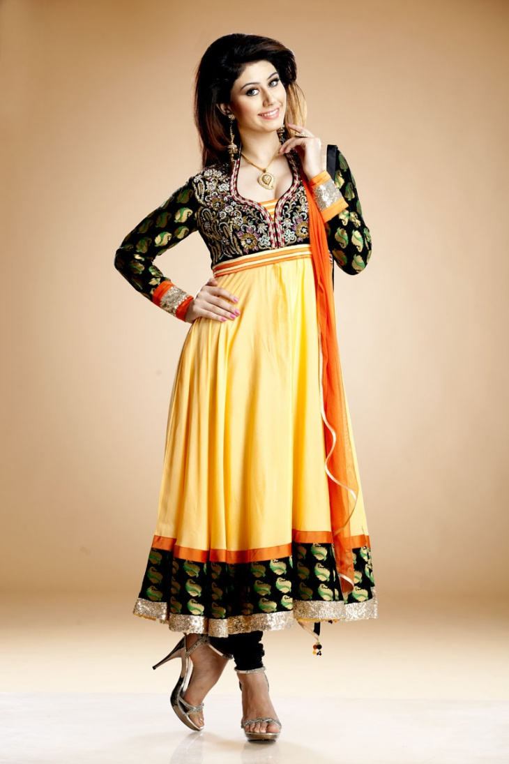 yellow and black churidar with deep star neck