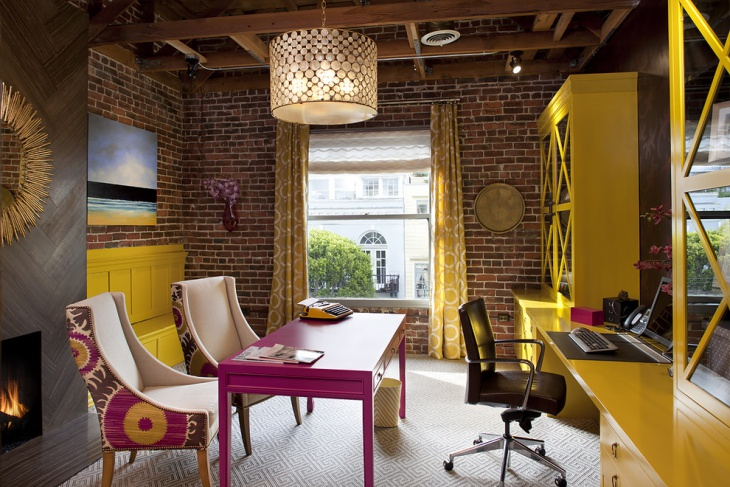 yellow home office with brick wall