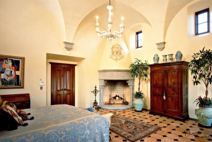 Mediterranean Bedroom Design With Fireplace