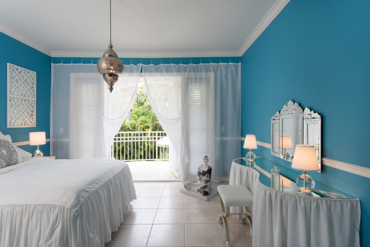 blue and white tropical bedroom