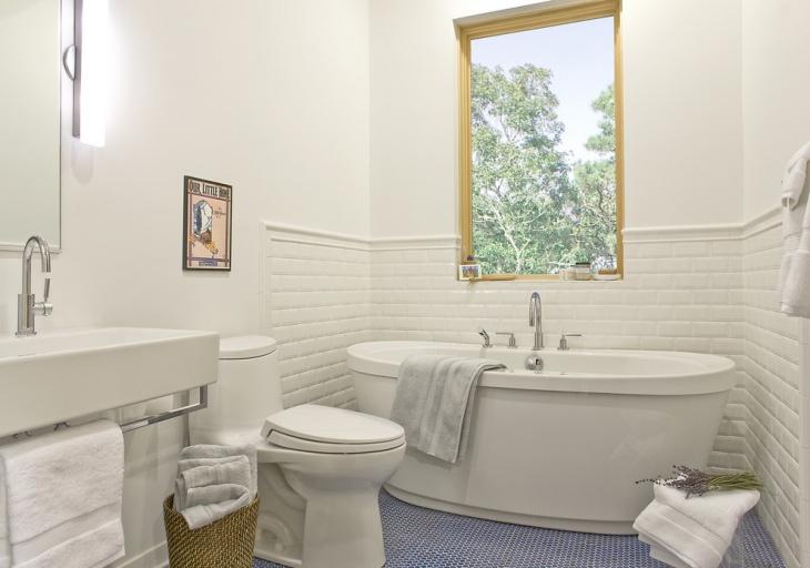 white bathroom with blue mosaic floor